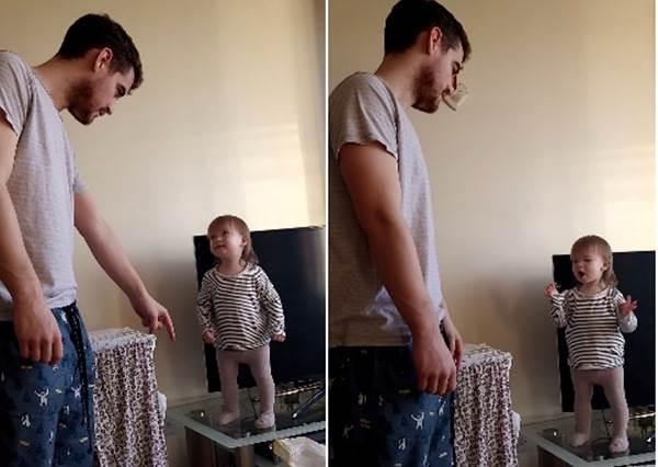 不想離開電視櫃!1歲女娃硬用「外星語」跟老爸吵架